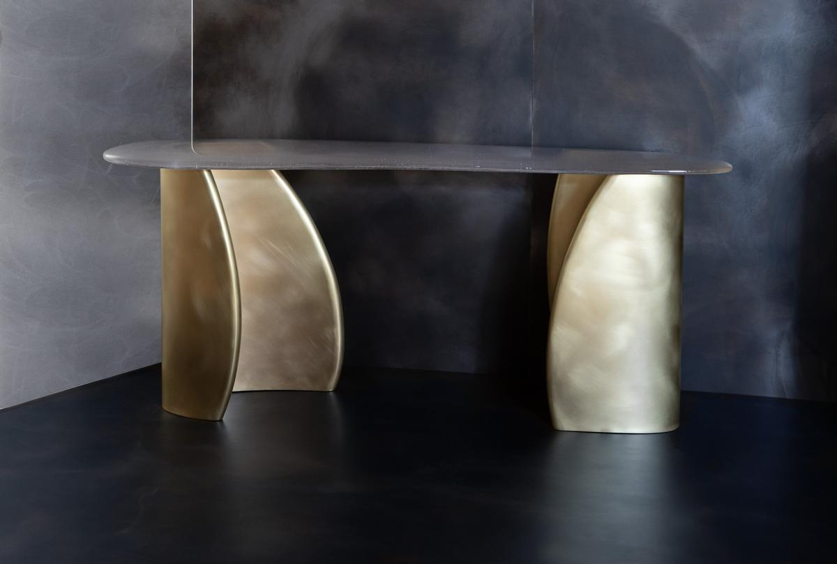 The Tidal Console table, consisting of a hand-poured glass table top set on a sculpted, polished base, completes the new line up