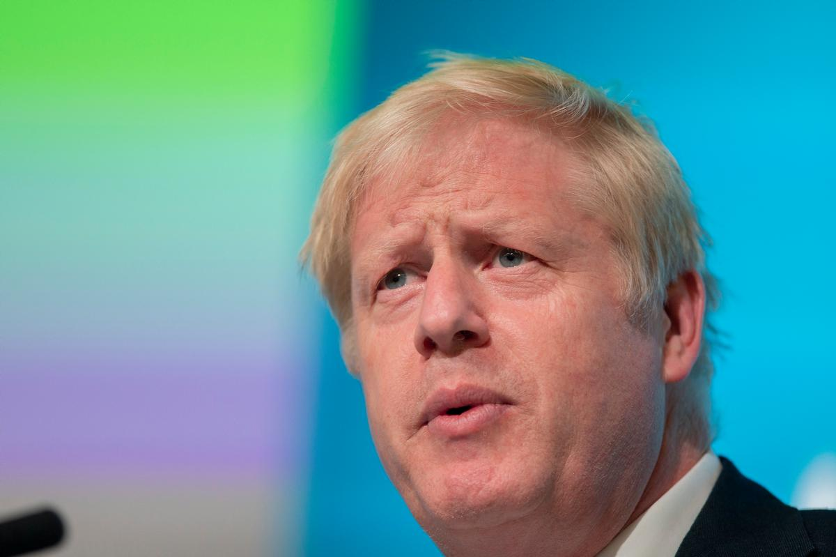 Boris Johnson attributed his stay in intensive care with COVID-19 to his 17 stone weight / Shutterstock/ComposedPix