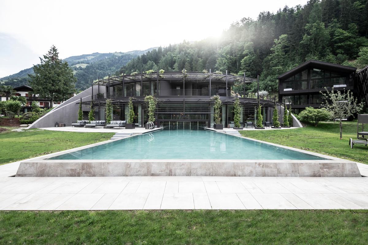 noa* reimagines alpine wellness retreat to merge seamlessly with mountain landscape