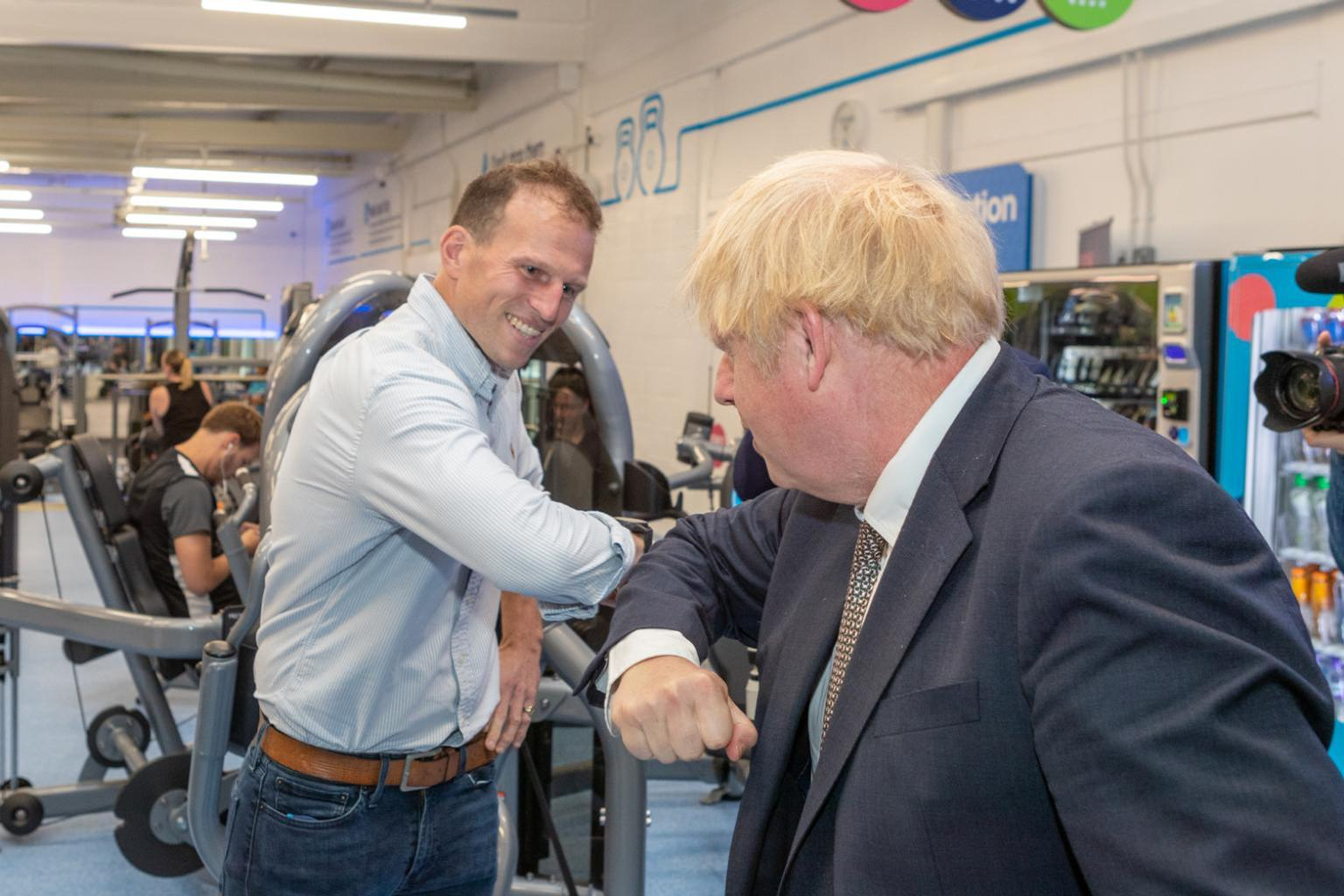 The PM's visit was hosted by Gym Group COO Barney Harrison (left) / Barney Harrison/LinkedIn/The Gym Group