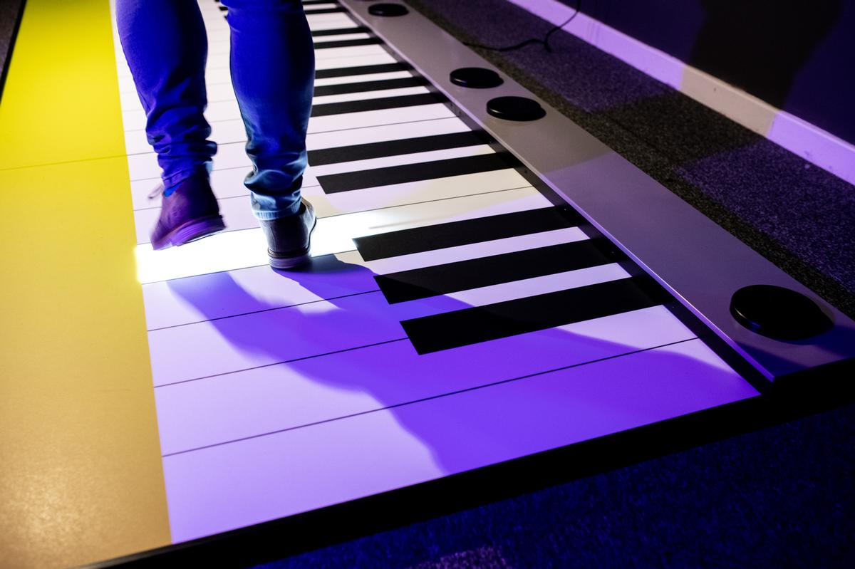 Step and Play is a giant interactive keyboard which allows users to create the authentic sound of the musical instrument by stepping on its keys / Technically Creative