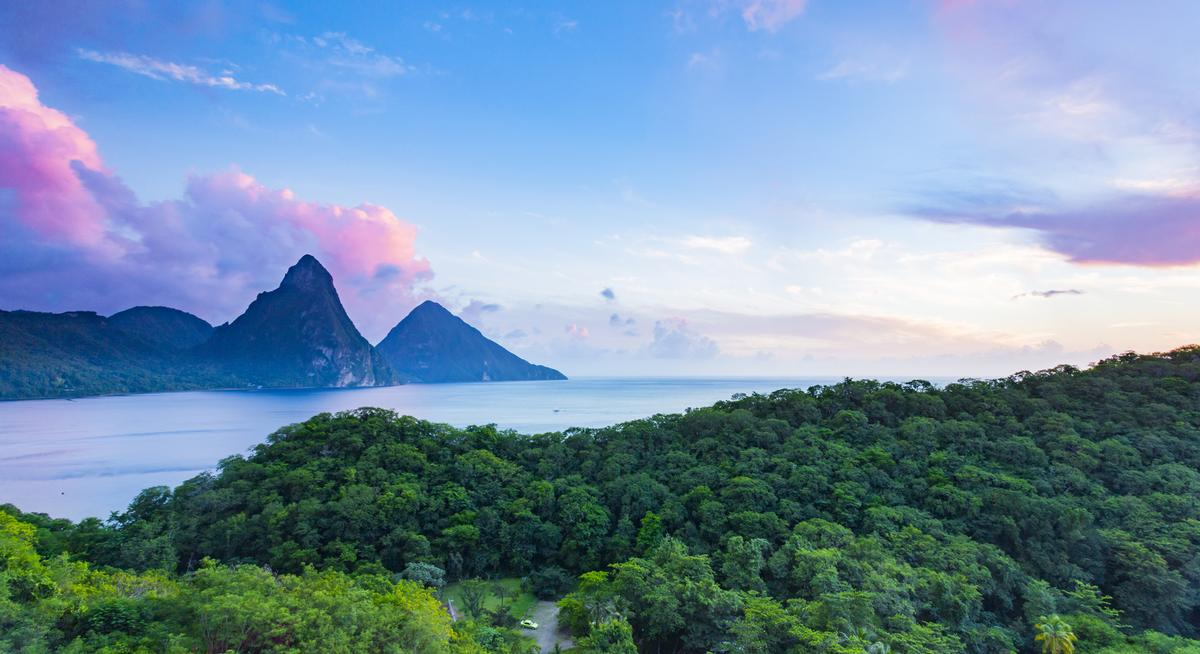 The resort will encompass two hilltops and command panoramic views of St. Lucia's famous volcanic spires – called Gros Piton and Petit Piton / Shutterstock/kentaylordesign