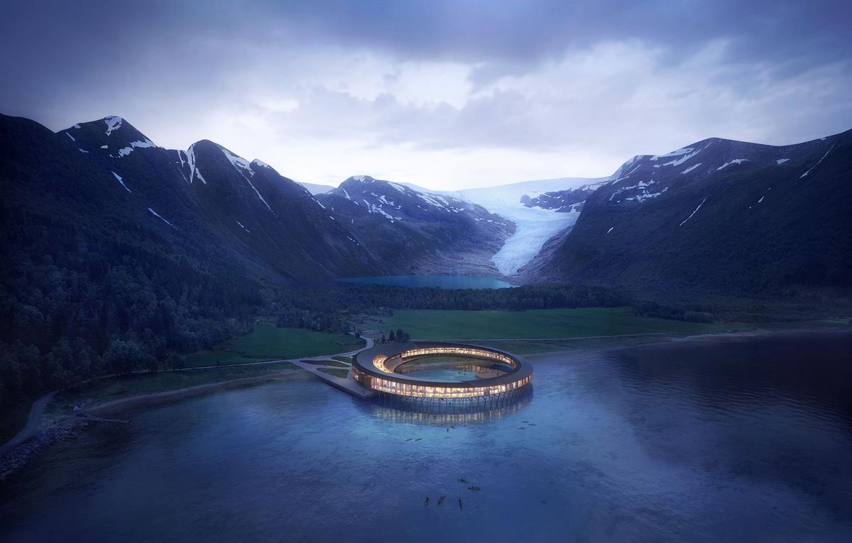 The glass-fronted, circular property will float on stilts above the Holandsfjorden fjord and is scheduled to open in late 2022 / Snøhetta