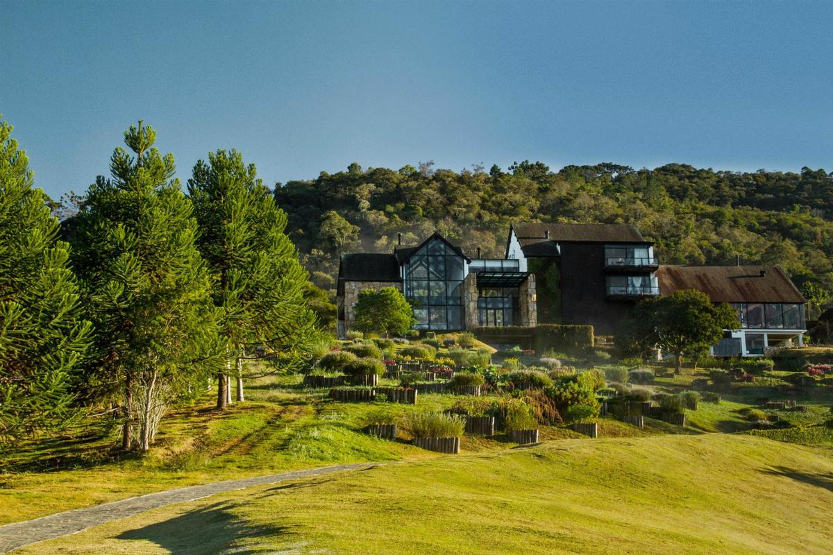 Regional architects and designers created the existing hotel and spa using indigenous materials such as jacaranda wood, natural stone and chocolate slate / Six Senses