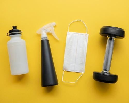 EuropeActive standards say members should bring their own water bottles, equipment must be virus free and masks should be worn to protect PTs / Shutterstock/KZLmax