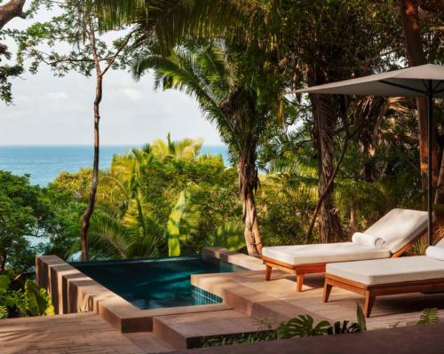 Overlooking the Pacific Ocean with a beachfront rainforest setting, One&Only Mandarina features 105 secluded eco-designed treehouses and cliff-top villas