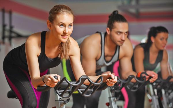 Something as simple as seat adjustability on an indoor bike can affect a user's experience / Shutterstock/RomanSo