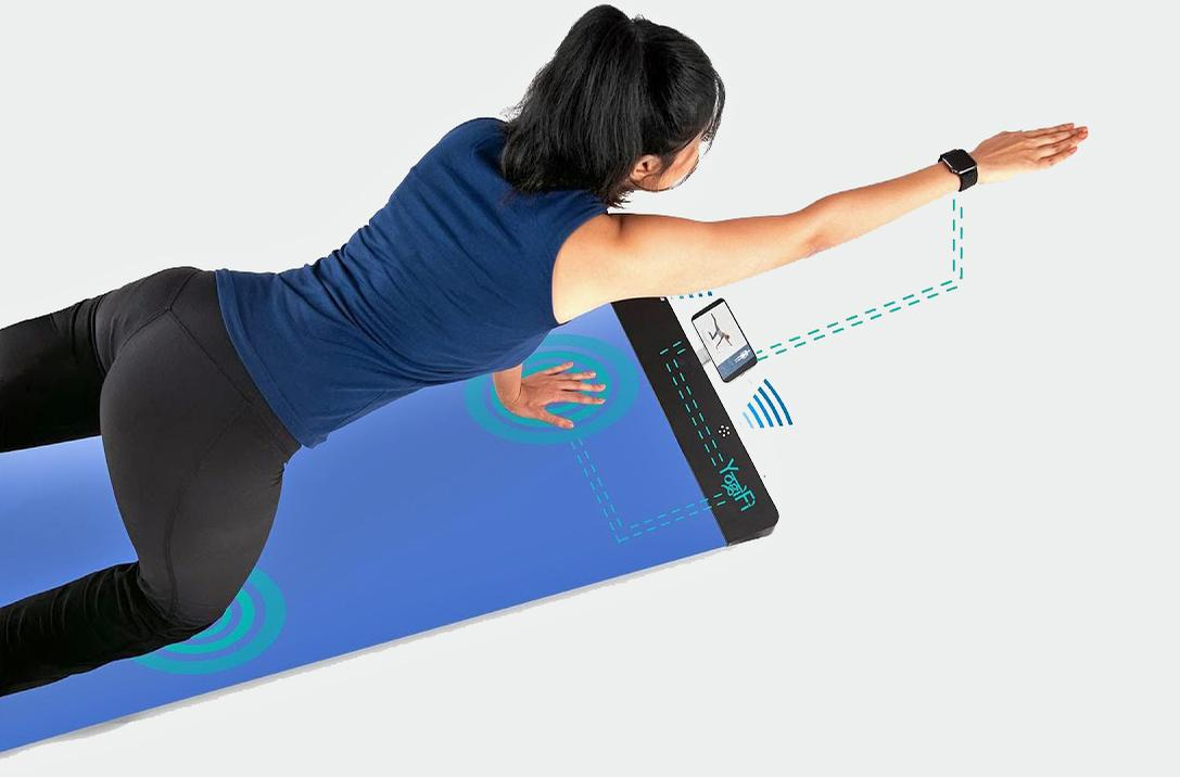 The mat uses artificial intelligence to automatically recommend personalised wellness programmes based on the user's history, current limitations and future goals / YogiFi