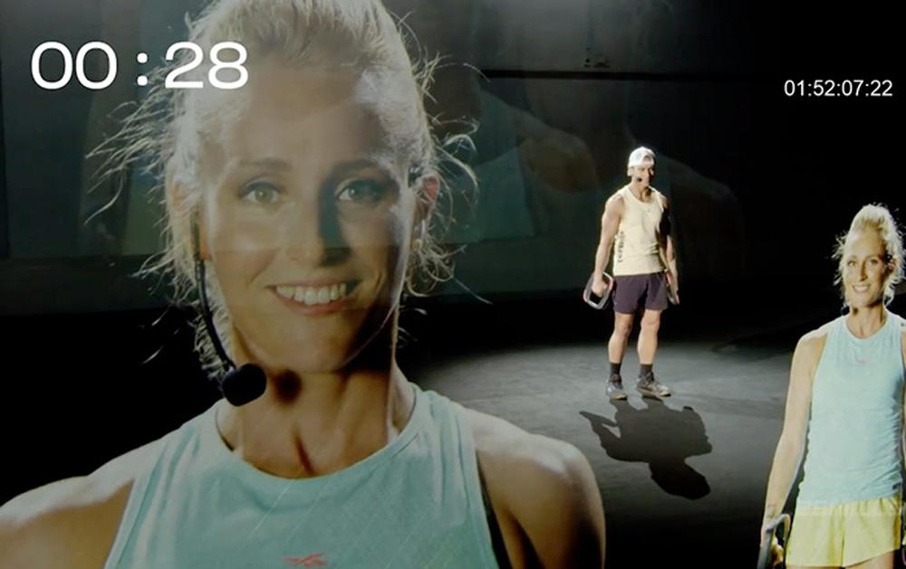 Les Mills used projected image technology, creating a type of hologram effect to show presenters from different countries in the same studio / Les Mills