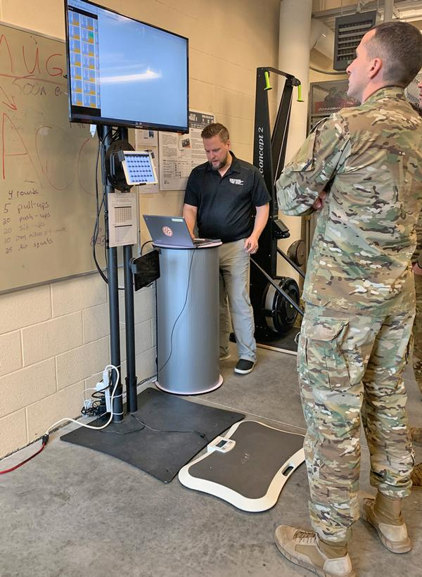 USAF Airmen view the results of their remote fitness training
