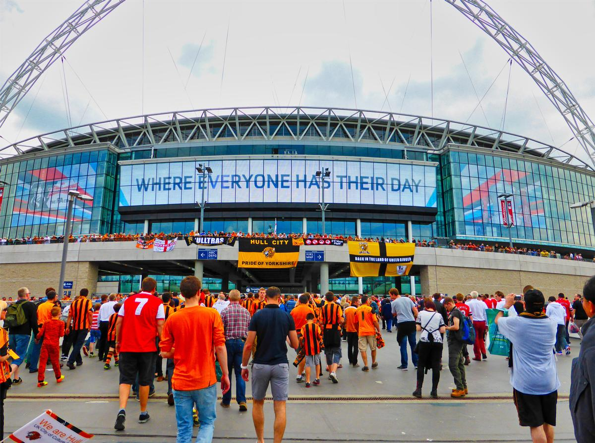 The FA Cup final on 15 May could see a large crowd return to Wembley (picture features fans ahead of the 2014 final) / Shutterstock/Steve Dornan