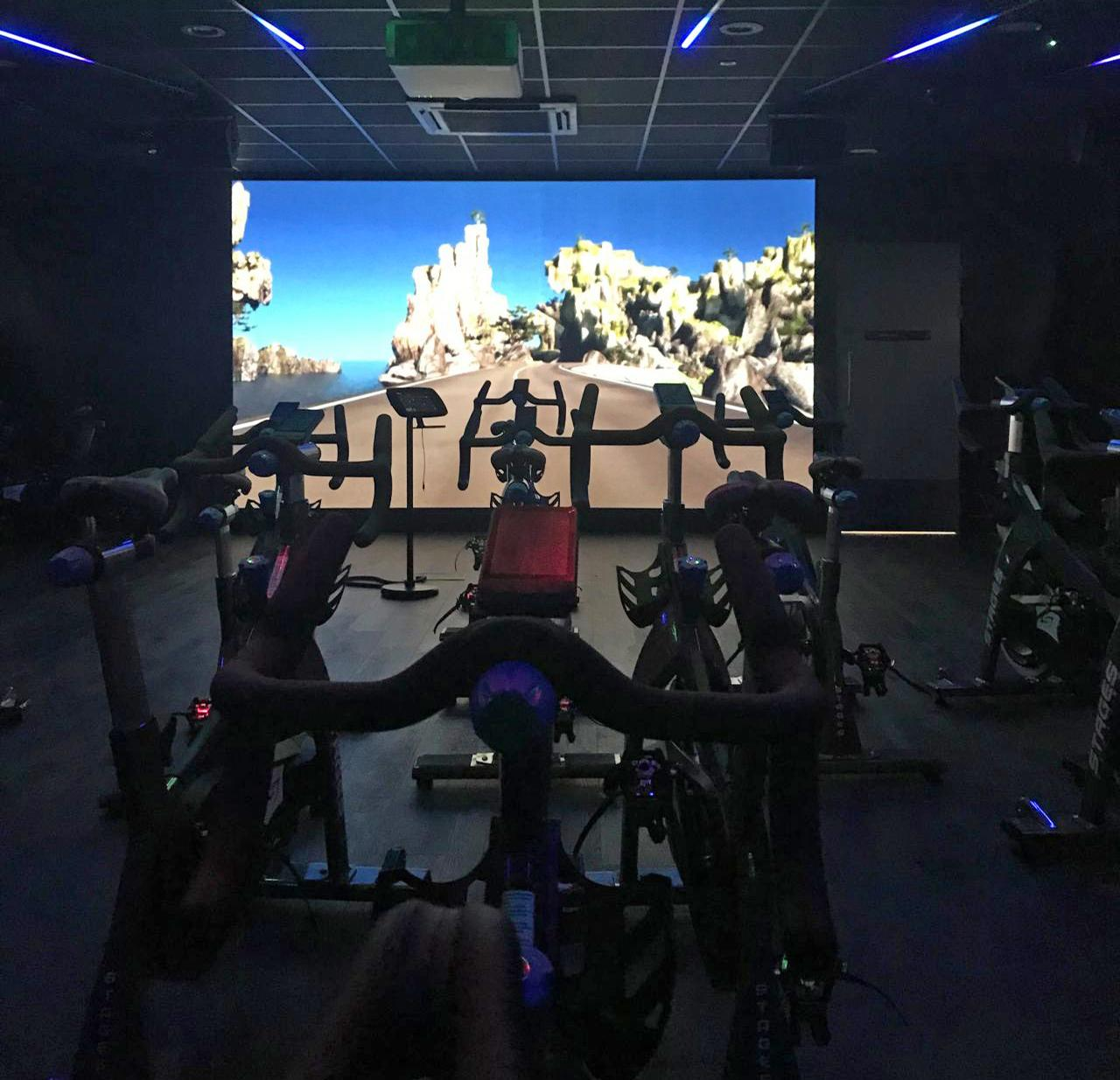 Group exercise spaces include a fully-immersive group cycling studio / LinkedIn/Dan Walker