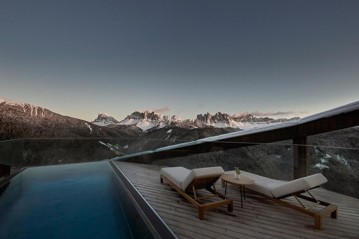 The wellness retreat is set against the backdrop of the breathtaking UNESCO World Natural Heritage Dolomites / Forestis