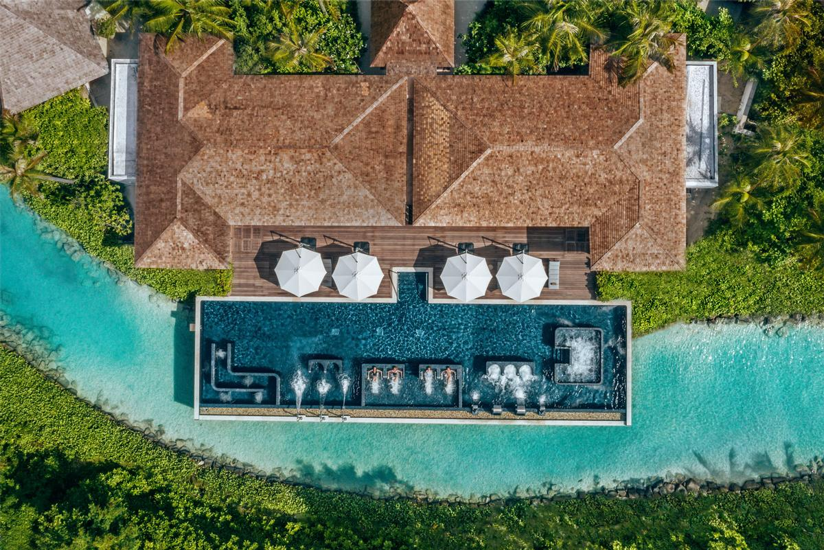 The hydrotherapy pool includes a range of zones – including jet bath, air jets, shower jets and massage loungers – that use varying levels of intensity and water temperature / Waldorf Astoria Maldives Ithaafushi