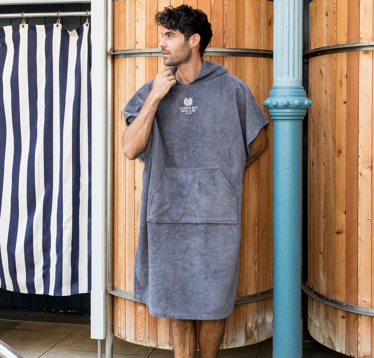 The ponchos are available in adult sizes in pebble and slate grey, with children's sizes available in slate grey / BC Softwear/ Thames Lido, Reading, Berkshire