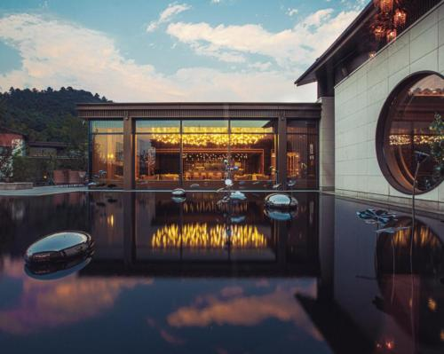 Dusit opens serene lakeside wellness resort with 18 hot spring pools in China