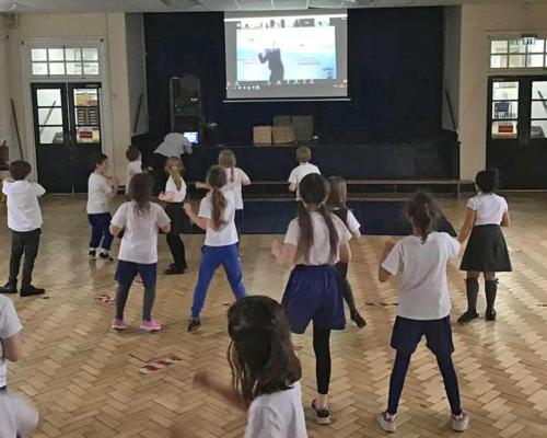Instructor Debbie Jones from 3d Leisure's Hearts Club in Crosby providing virtual sessions for children at Mosspits Lane Primary School / 3d Leisure