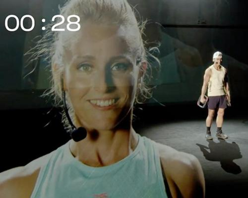 Les Mills used projected image technology, creating a type of hologram effect to show presenters from different countries in the same studio