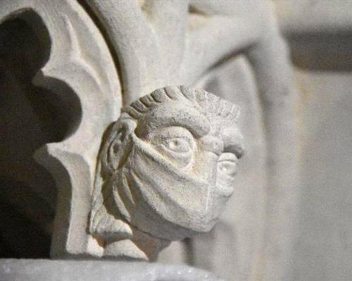 Face mask added to St Albans cathedral's medieval carvings as part of restoration project