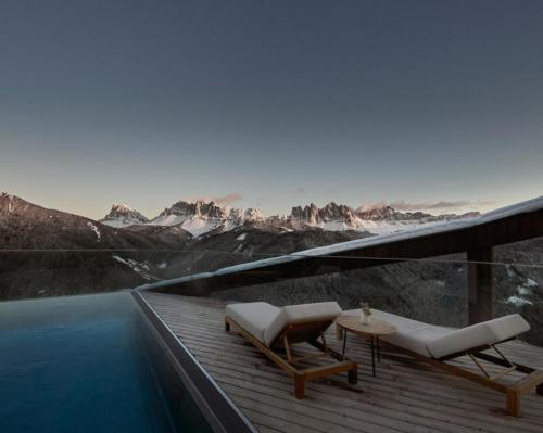 The wellness retreat is set against the backdrop of the breathtaking UNESCO World Natural Heritage Dolomites