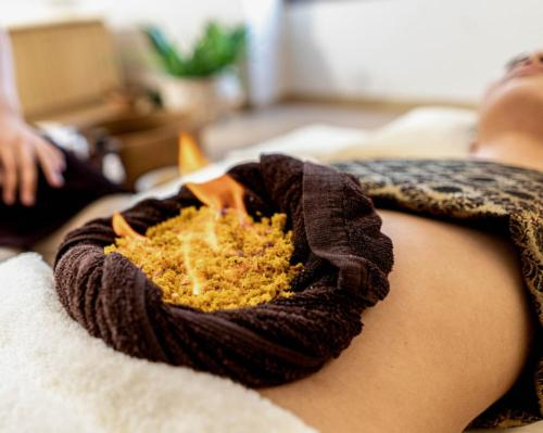 RAKxa's Long-Covid retreat sees therapists burn herbal paste on guests' stomachs to detoxify respiratory system