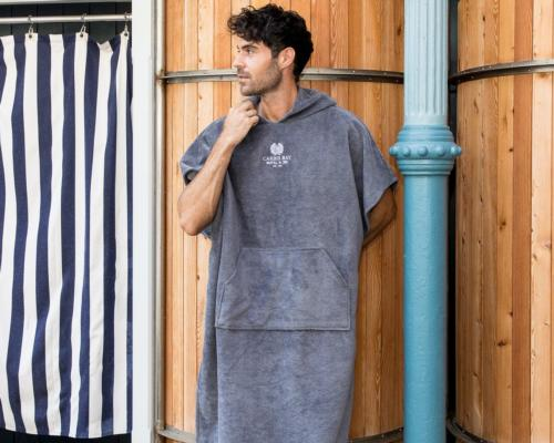 The ponchos are available in adult sizes in pebble and slate grey, with children's sizes available in slate grey