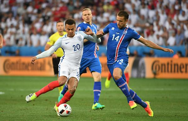 Iceland's Amason attempts to take the ball from England's Alli / Jonathan Brady / press association