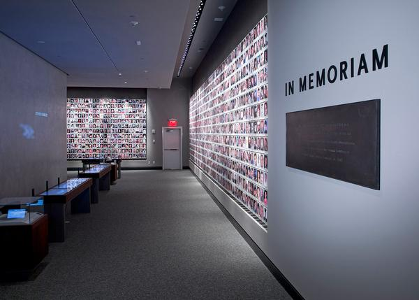 The Wall of Faces, part of the In Memoriam exhibition, communicates the scale of human loss to visitors