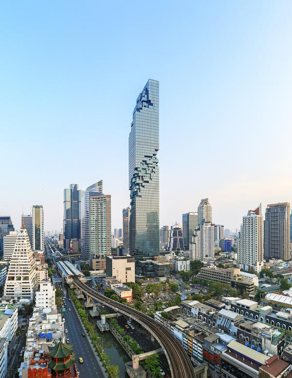 The tower features a 'pixelated' exterior and a series of dramatic cantilevering terraces