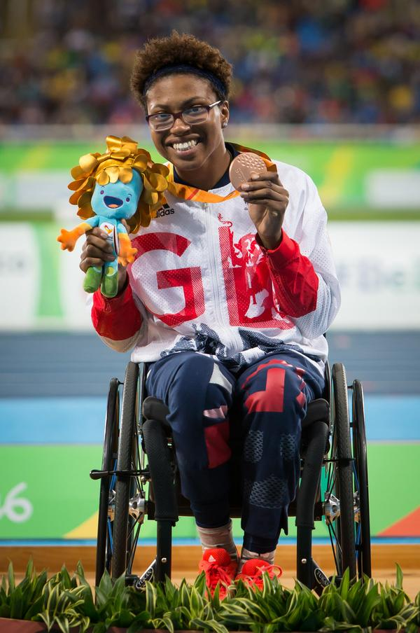 Kare Adenegan won a silver and two bronze in wheelchair racing