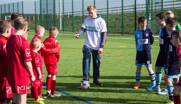 Sunderland footballer Duncan Watmore talks to youngsters as he opens a new 3G pitch in Bishop Auckland