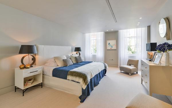 The original windows bring charm to the master bedroom