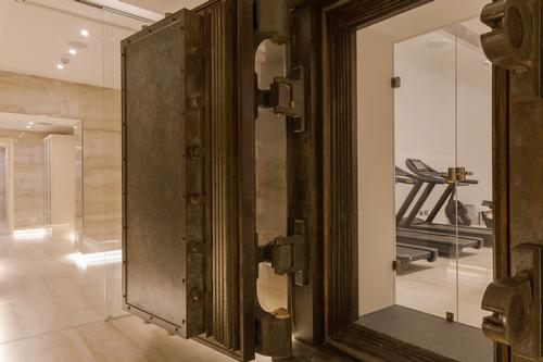 A state-of-the-art gym with Technogym machines is housed in the original bank vault