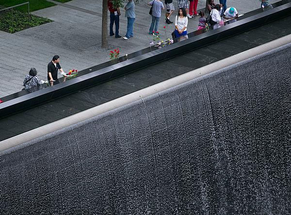 Victims' names carved around the edges of two acre-sized waterfall pools at the Memorial Plaza