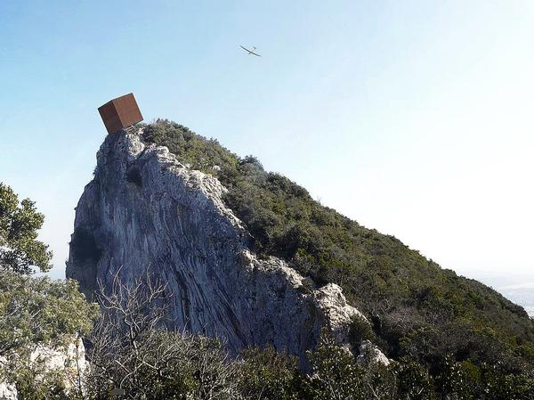 The cube appears to be about to tip over the edge of the cliff. It provide a space to rest and take in the views / Christophe Benichou