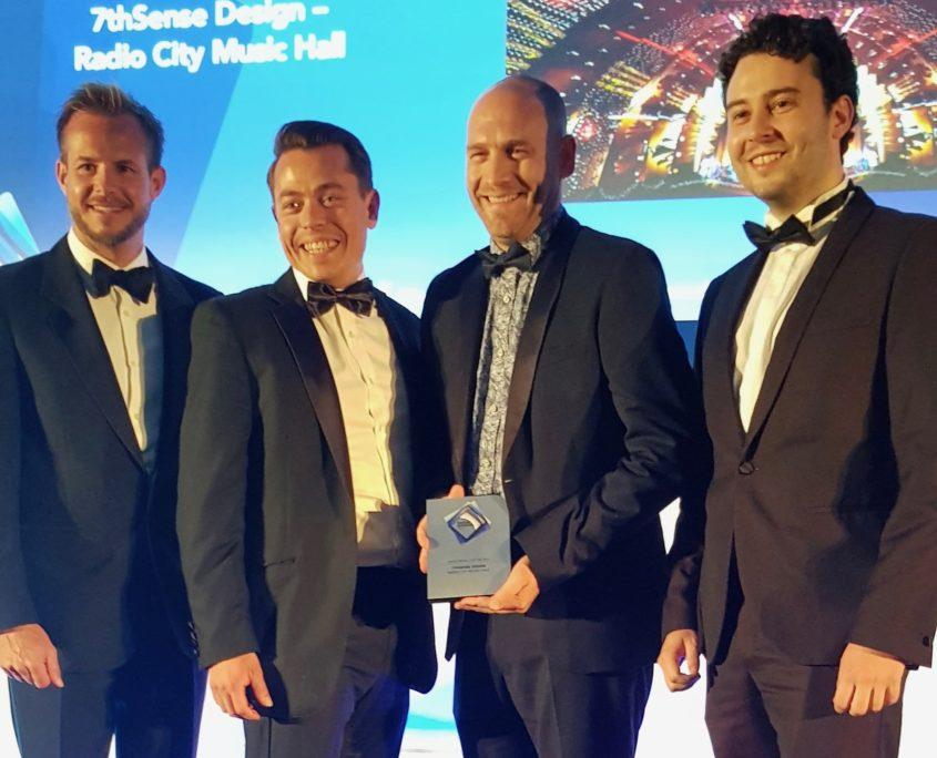 7thSense MD Matt Barton, second from right, and team members accept the award for Venue Project of the Year