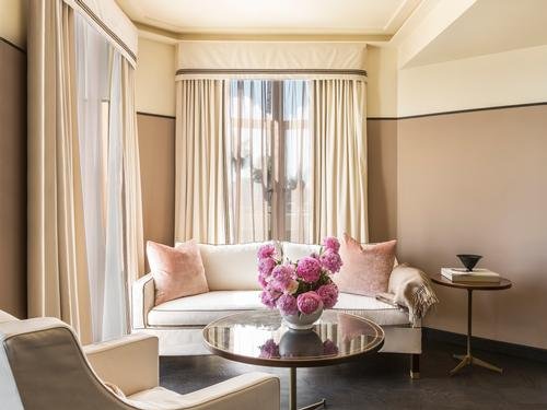 Each of the rooms has been enriched with dusty pinks, soft creams and brown accents