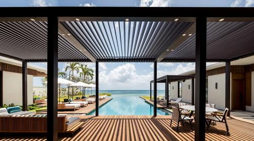 Exterior spaces echo the architecture's modern lines through gardens, courtyards and water features., and terraces, daybed areas and pools are designed to blend into the architecture