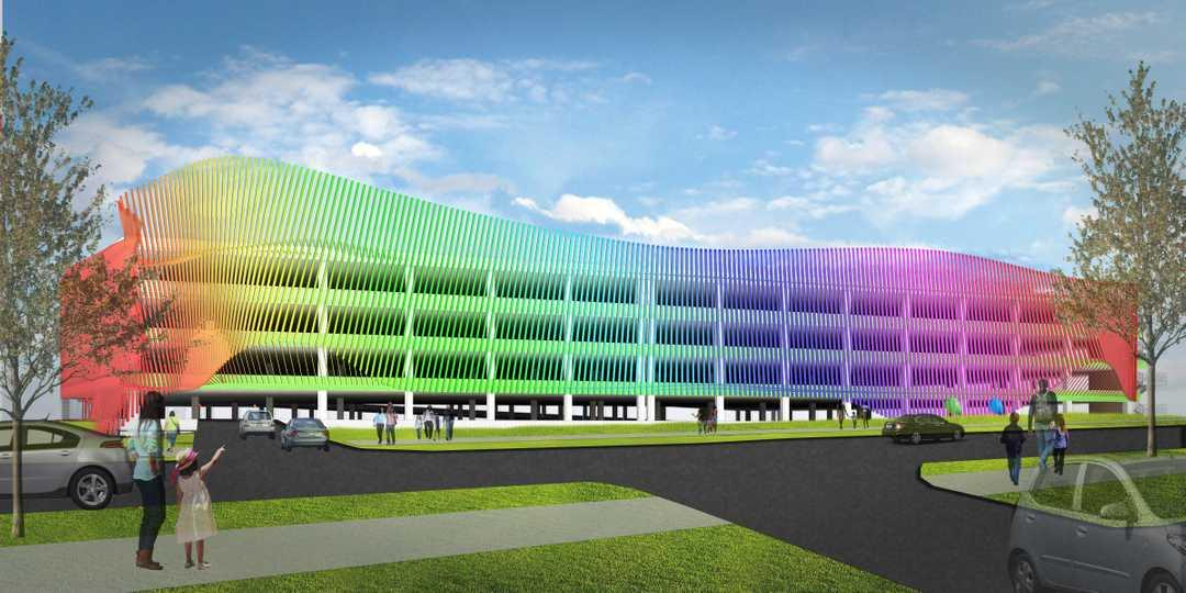 The project includes a multi-coloured, curved facade parking garage
