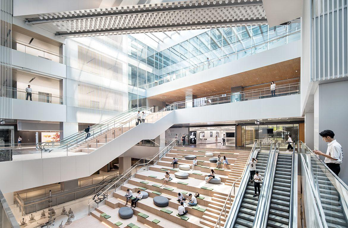 Formerly a shopping centre, the reincarnation is now primarily a business proposition, with office spaces being its main function. However, the space has kept up some of the leisure offering. / Yuzhu Zheng