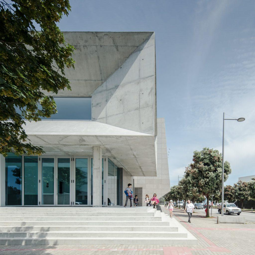 The complex has a brutalist-style facade and consists of various sharp and pointed edges