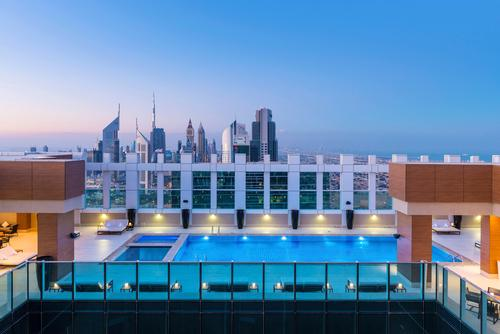 The rooftop pool gives stunning views of the Dubai skyline / Sheraton