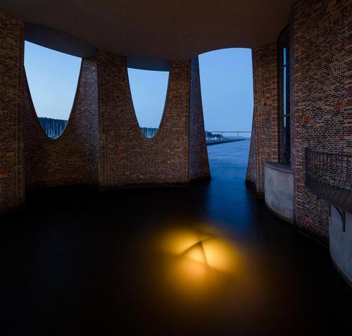 At night the building, which is set with a number of internal lights, resembles a lighthouse. / Photo by Anders Sune Berg