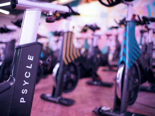 Psycle uses high intensity interval and low impact exercises conducted on a bike / Psycle