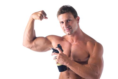 Muscle-building supplements are widely popular among male gym users / Shutterstock.com / Stefano Cavoretto