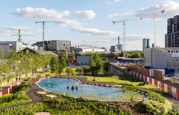 The pool is surrounded by grass and trees and has a viewing deck, changing rooms, sauna and showers. It's part of the Kings Cross public art programme, Relay / IMAGE: JOHN STURROCK