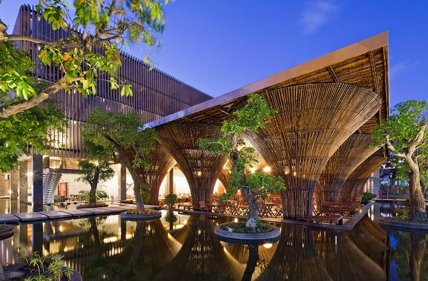 A restaurant designed for Kontum Indochine Hotel supported by huge bamboo columns