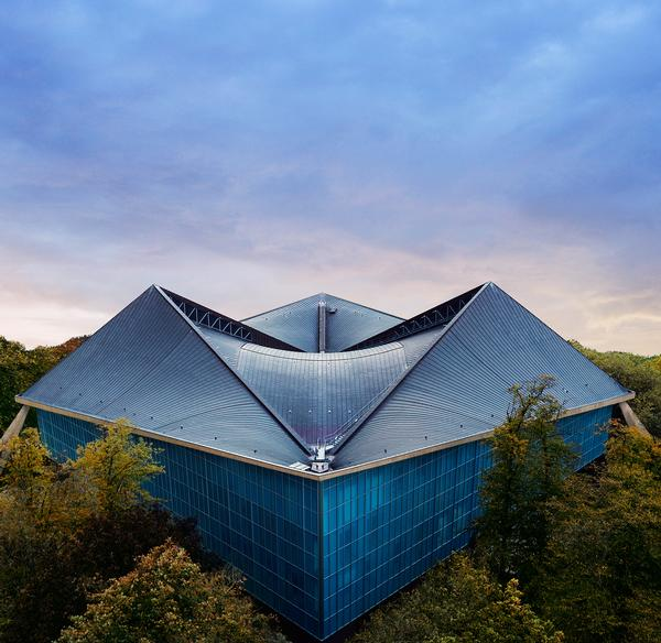 The original copper-covered hyperbolic paraboloid roof was restored and used as the focal point for the design
