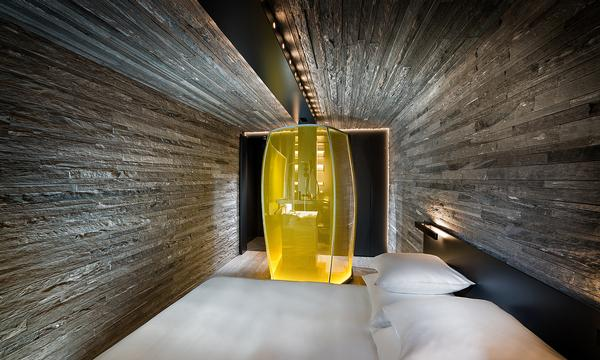 Bedrooms feature illuminated showers made by Cricursa from hot-bent glass. They're 'objects of desire, which animate the rooms' says Mayne