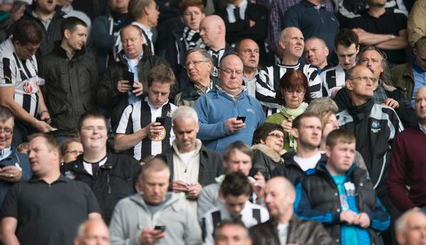 Smartphones now form a part of the match day experience for most fans / press association